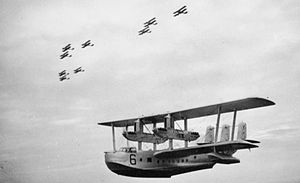 No. 205 Squadron RAF - Short Singapore Mark III flying boat of No. 205 Squadron in flight below three 'vic' formations of Vickers Vildebeest torpedo bombers of No. 100 Squadron, both units based at RAF Seletar.