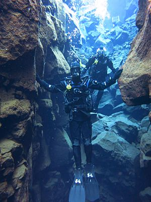 Silfra - The diver's right hand is on the North American Plate and the left hand on the Eurasian Plate