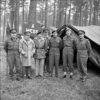 II Canadian Corps - Field Marshal Sir Bernard Montgomery (third from left) shown along with senior commanders of the First Canadian Army while visiting the headquarters of II Canadian Corps, near Kleve, February 1945.  From left to right: Major General C. Vokes (4th Canadian Armoured Division), General H. D. C. Crerar (First Canadian Army), Field Marshal Sir Bernard L Montgomery (21st Army Group, Lieutenant General B. G. Horrocks (XXX (British) Corps, attached to First Canadian Army), Lieutenant General G. G. Simonds (II Canadian Corps), Major General D. C. Spry (3rd Canadian Infantry Division), and Major General A. B. Matthews (2nd Canadian Infantry Division).