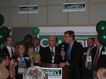 Campbell is joined by Mark Warner at a campaign event. Skip Campbell with Governor Mark Warner (127966597).jpg