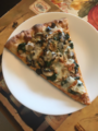 Slice of pizza with spinach, mushrooms, black olives, and turkey meatball.png