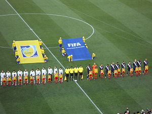 2010 FIFA World Cup Group C - The Slovenia and United States teams line up for the national anthems before the game