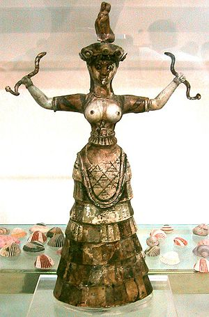 Confronted animals - Figure from Crete, holding confronted snakes, dated 1600 BC.