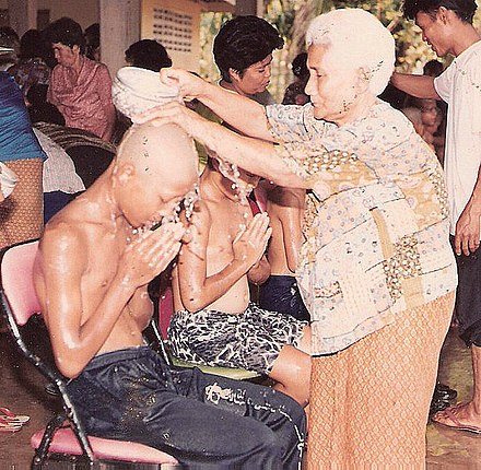 Before take ordination in Buddhism, Thai boys respect to their elders, in the Songkran Festival. Songkran in Wat Kungthapao 02.jpg
