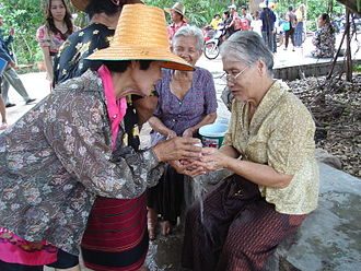 Songkran (Thailand) - New Year celebration, Rot Nam Dam Hua, a traditional way to celebrate with elders. Most Thai people go back to their hometowns to meet their elders.