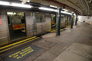 Platform gap filler - South Ferry station with gap fillers extended out to a 1 train, as reopened on April 4, 2013.