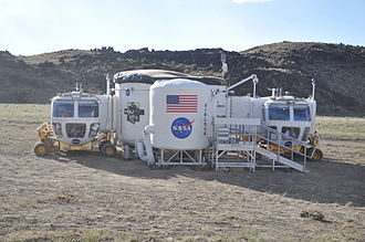 Space Exploration Vehicle - The two rover prototypes docked to the Habitat Demonstration Unit during DesertRATS 2010