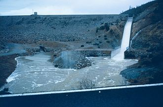 Spring Creek Dam - Spring Creek Dam releasing floodwaters in November 1994. The chute at right is the spillway and the outlet works is visible to the left.