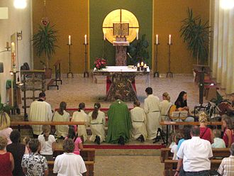Genuflection - Genuflection on one knee, during a Catholic Mass
