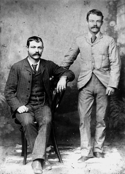 431px-StateLibQld_2_139509_Two_men_posing_for_a_portrait%2C_1880-1890.jpg