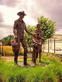 Statue of an early 20th-century family, in Centennial Park on Main Street