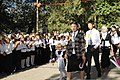 Students in their last year of school escort first-year students to class during a First Bell ceremony in Niznechuiskiy village, Kyrgyzstan, Sept 120901-F-ER469-064.jpg
