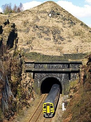 Summit Tunnel - Northern Rail Class 158 emerges from Summit Tunnel southern portal near Littleborough