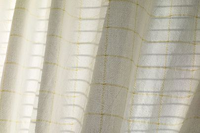 Sunlight and shadows on white cotton curtain.jpg