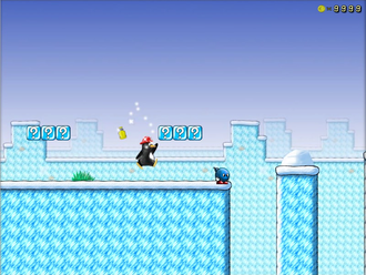 Saved game - Tux passes a checkpoint (the yellow bell) in the video game SuperTux.