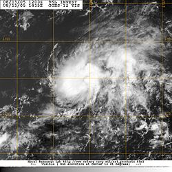 Satellite image of elliptical cloud pattern with no clear center.