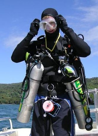 Technical diving - Technical diver with decompression gases in side mounted stage cylinders