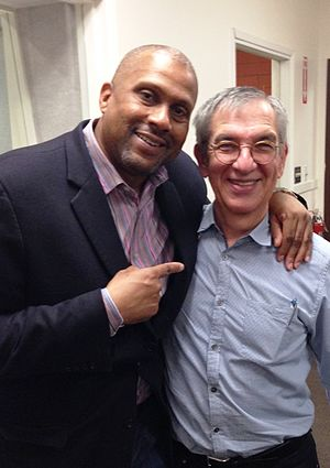 Tavis Smiley - Smiley with historian Jon Wiener on his political podcast entitled Start Making Sense in 2015