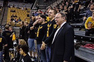 The Antlers (University of Missouri) - Former Chancellor R. Bowen Loftin looks on as The Antlers cheer on a women's basketball game.