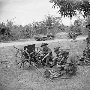 Type 1 37 mm anti-tank gun - Soldiers examine a captured Japanese 37mm anti-tank gun, January 1945