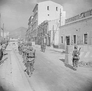 138th (Lincoln and Leicester) Brigade - Men of the 6th Battalion, York and Lancaster Regiment, part of the 138th Brigade, British 46th Infantry Division, enter Salerno during the Allied invasion of Italy, 10 September 1943.