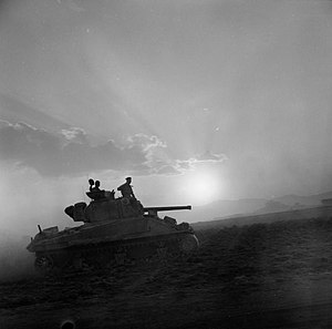23rd Armoured Brigade (United Kingdom) - A Sherman tank of 'A' Squadron, 50th Royal Tank Regiment, silhouetted by the setting sun, Sicily, 1 August 1943.