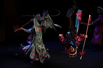 Chinese opera - A Shao opera performance in Shanghai, China, 2014. This photo shows an acrobatic performer's somersault.