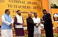 The President, Shri Pranab Mukherjee presenting the National Award for Teachers-2015 to Dr. Raj Kumar Srivastava (Jharkhand), on the occasion of the 'Teachers Day', in New Delhi.jpg