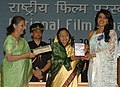 """The President, Smt. Pratibha Devisingh Patil presenting the Award for Best Actress to Ms. Priyanka Chopra for Hindi film """"Fashion"""", at the 56th National Film Awards function, in New Delhi on March 19, 2010.jpg"""