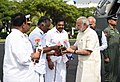 The Prime Minister, Shri Narendra Modi being welcomed by Deputy Chief Minister of Tamil Nadu, Shri O. Panneerselvam, on his arrival at Chennai on November 06, 2017 .jpg