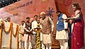 The Prime Minister, Shri Narendra Modi lighting the lamp to inaugurate the National Tribal Carnival-2016, in New Delhi.jpg