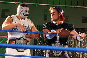 Chikara Campeonatos de Parejas - The Throwbacks (Dasher Hatfield and Mark Angelosetti) with the title belts in September 2014