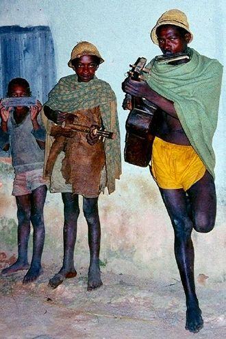 Music of Madagascar - Betsileo farmers playing harmonica, kabosy and guitar
