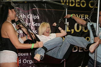 Tickling game - A woman being tickled at EXXXOTICA New York 2009