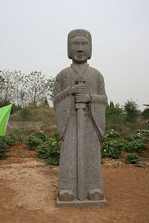 Emperor Xuanwu of Northern Wei - A stone-carved tomb statue with sword standing guard outside the Luoyang tomb of Emperor Xuanwu
