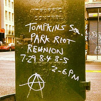 Tompkins Square Park riot (1988) - Graffiti on a traffic signal box in the East Village advertising riot reunion concerts in 2012
