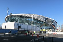27da9c5e395fb Stadium nearing completion in February 2019. Last section of metal cladding  panels being installed.