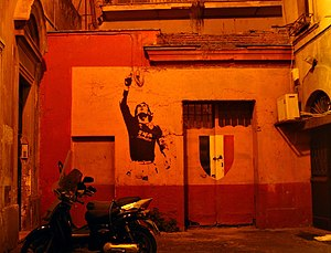 Francesco Totti - Decal of Totti alongside the Scudetto shield, displayed on a house in Rome
