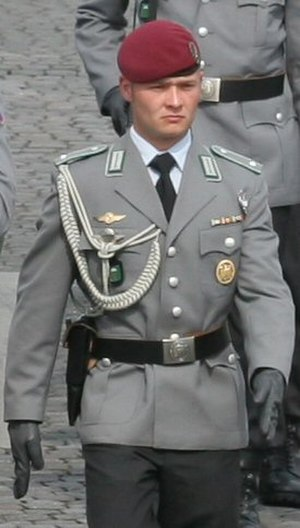 German Armed Forces Badge for Military Proficiency - German airborne officer wearing the gold level badge centered on his left breast pocket as prescribed by Bundeswehr dress regulations.