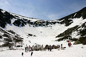 Tuckerman Ravine - Tuckerman Ravine with late spring skiers after the headwall has thawed