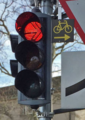 Turning on red signal for cyclists road sign, Switzerland (cropped).png