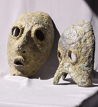 Dvora Bochman - Image: Two paper mache mask with feet grey background