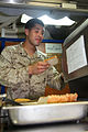 U.S. Marine Corps Cpl. Francisco A. Arredondo, motor transportation operator, 2nd Platoon, Battery B, Battalion Landing Team 3-5, 15th Marine Expeditionary Unit, toasts bread on the mess deck of USS Rushmore 130425-M-VZ265-010.jpg