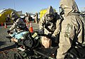 U.S. National Guardsmen assigned to the Chemical, Biological, Radiological, Nuclear and high-yield Explosives Enhanced Response Force Package, Oregon National Guard check for vital signs of simulated victims 140327-Z-CH590-356.jpg