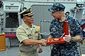 U.S. Navy Capt. Paul Schlise, right, the commodore of Destroyer Squadron 7, accepts an award of appreciation from Philippine Navy Capt. Karl A. Decapia during the closing ceremony for Cooperation Afloat 140701-N-PK322-086.jpg