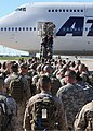 U.S. Service members at Fort Worth, Texas, board an airplane bound for Agadir, Morocco, April 5, 2012, in support of African Lion 2012 120405-A-JC300-110.jpg