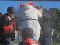 USCGC Heriberto Hernandez hands over a murder suspect - 210107-G-G0101-1001.jpg