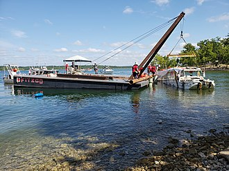 Table Rock Lake duck boat accident - The boat involved in the accident is retrieved from the bottom of Table Rock Lake