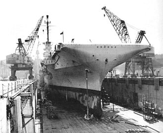 USS Essex (CV-9) - USS Essex (CVS-9) in drydock at Brooklyn Navy Yard being converted for the Anti-submarine role.