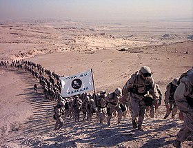 US Navy 021231-A-3447F-001 Seabees make their way up Mutla Ridge during a 7-mile march on New Year's Eve, 2002.jpg
